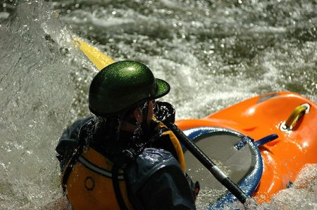 close up of kayaker in rapids