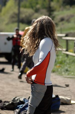 female rafting guide getting ready for work Stock Photo