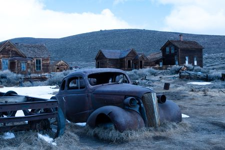 junk car and abanonded homes in bodie, ca. Stock Photo