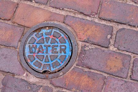 iron water pipe cap in brick side walk