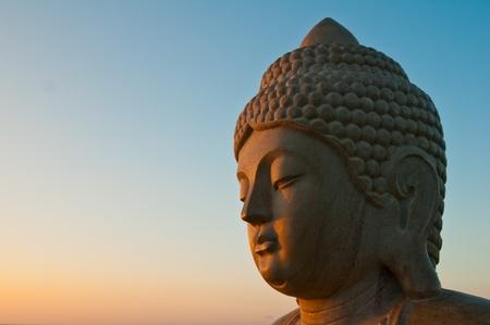 buddha statue at sunrise