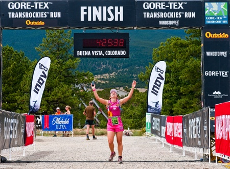 Buena Vista, CO - Aug 21, 2011: Luciana cox of Brazil finishes the 20.2 mile stage 1 race of the Run3 Gore-Tex TransRockies. Editorial