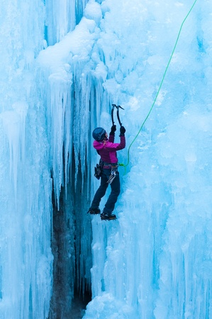 motivational: portrait of woman climbing ice