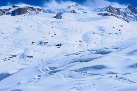 ascends: A small group of skiers ascends to the Monte Rosa Hut near Zermatt, Switzerland Stock Photo
