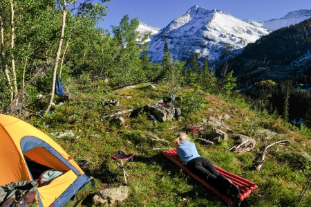 bivouac: soaking up late afternoon sun on an alpine bivouac site Stock Photo