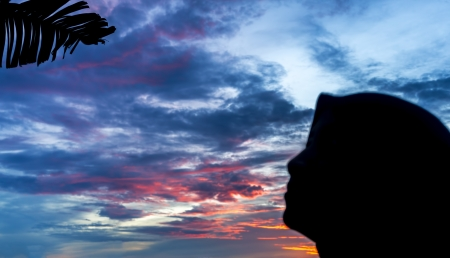 Hijab woman silhouette with sunset background photo