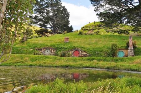 villages: Hobbiton, Shire, New Zealand. Reflection of house on lake. Stock Photo