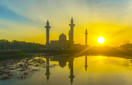 alam: The Tengku Ampuan Jemaah Mosque, Bukit Jelutong, Malaysia mosque silhouetted at sunrise.