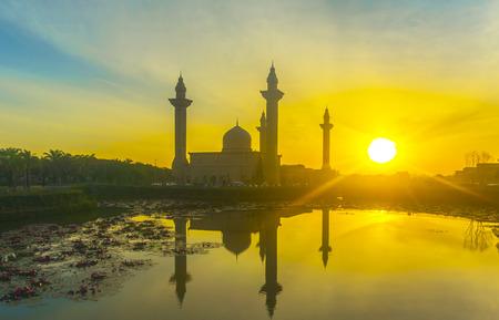 islamic wonderful: The Tengku Ampuan Jemaah Mosque, Bukit Jelutong, Malaysia mosque silhouetted at sunrise.