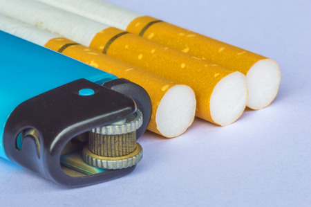 Lighter macro with blurred cigarette background photo