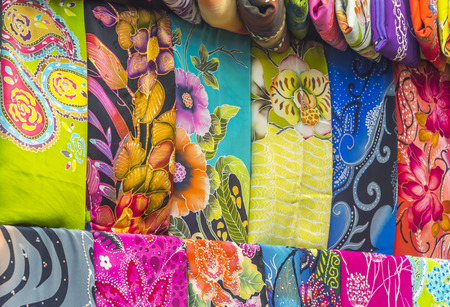 Mass produced colored textile in a traditional east market in Malaysia photo