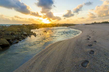terengganu: Foot mark on sand with beautiful sunrise background