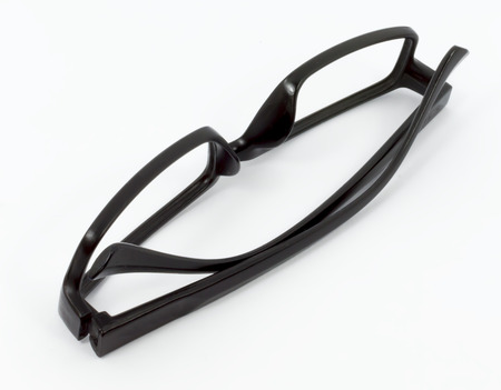 rimmed: black glasses on a white background