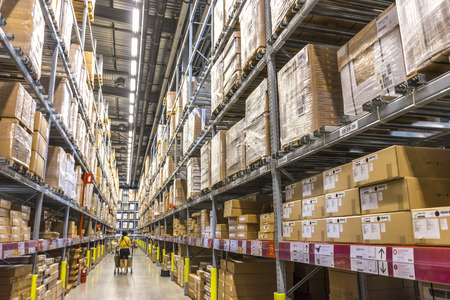 home store: KUALA LUMPUR, MALAYSIA - JANUARY 25, 2015: Warehouse storage in an IKEA store. Founded in 1943, IKEA is the worlds largest furniture retailer. IKEA operates 351 stores in 43 countries.