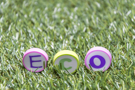button grass: ECO rubber and blurred green grass with selective focus Stock Photo