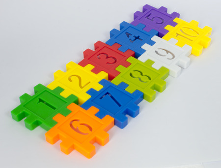 large group of object: Colorful toy of numbers with white background