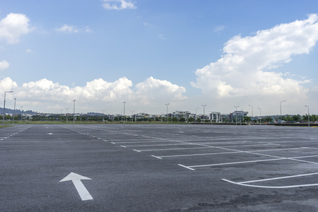 Empty parking lot with blue skies photo
