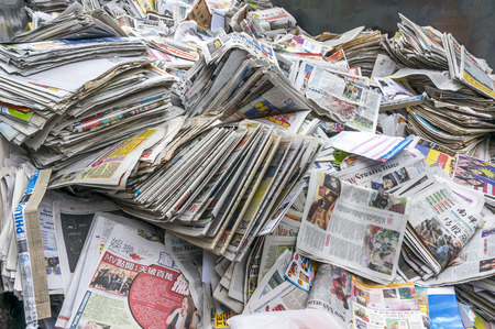 newspaper stack: A stack of old newspaper for recycle Editorial