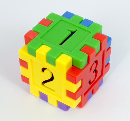 large group of object: Colorful toy cube of numbers with white background