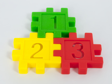 small group of objects: Colorful toy of numbers with white background
