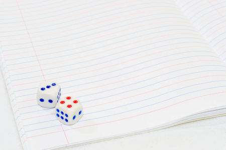 Dice with white paper