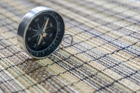 string together: Compass with bamboo mat Stock Photo