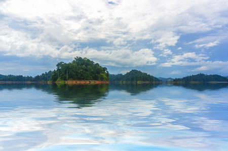 relaxion: rainforest island with cloud reflection Stock Photo