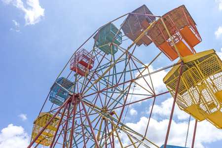 acrophobia: Ferris wheel and natural sunlight with blue skies Stock Photo