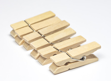 pegs: Wooden Cloth Pegs with on White Background