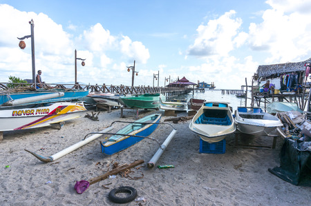 mabul: SABAH, MALAYSIA - AUGUST 16, 2016 : A view of boats at Mabul Island villages. The coral seas around the island is a favorite scuba diving site.