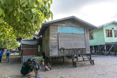 mabul: SABAH, MALAYSIA - AUGUST 16, 2016 : A view of poor wooden house and people at Mabul Island, Sabah Malaysia.