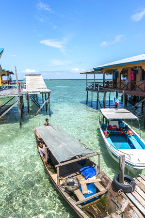 mabul: SABAH, MALAYSIA - AUGUST 16, 2016 : A view of travel boat and beautiful water at Mabul Island, Malaysia.