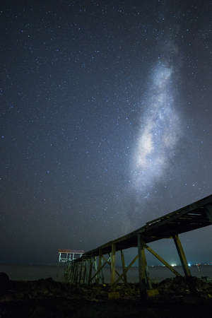 jetty: Milkyway with jetty foreground silhouette. Slighty noise due to high ISO