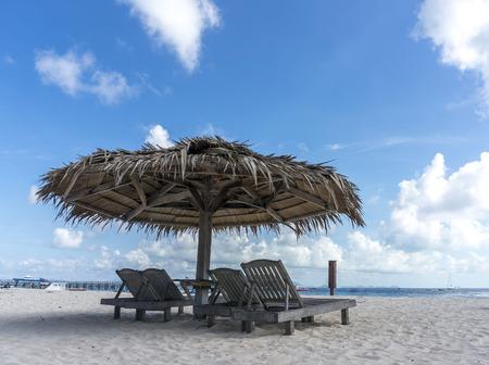 mabul: Dreamy beach with sun loungers under a beach umbrella at Mabul, Semporna Sabah Stock Photo