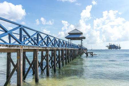 mabul: Jetty with beautiful beach