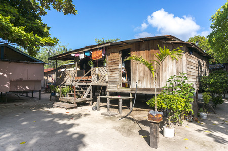 mabul: MABUL ISLAND, MALAYSIA - AUGUST 16, 2016 : View of poor wooden house and villagers at Mabul Island, Malaysia. Editorial
