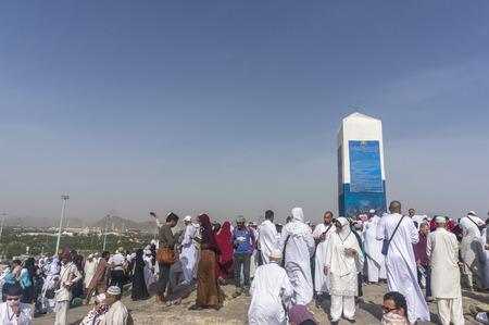decentralization: MECCA, SAUDI ARABIA - MAR 11: Muslims at Mount Arafat (or Jabal Rahmah) March 11, 2015 in Arafat, Saudi Arabia. This is the place where Adam and Eve met after being overthrown from heaven. Editorial