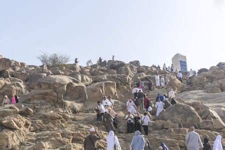 adam eve: MECCA, SAUDI ARABIA - MAR 11: Muslims at Mount Arafat (or Jabal Rahmah) March 11, 2015 in Arafat, Saudi Arabia. This is the place where Adam and Eve met after being overthrown from heaven. Editorial