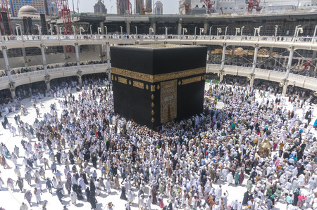 MECCA, SAUDI ARABIA-MAC 09, 2015: WIde angle view of Muslim pilgrims circumambulate the Kaaba counter-clockwise at Masjidil Haram in Makkah, Saudi Arabia. Stock Photo - 44426453