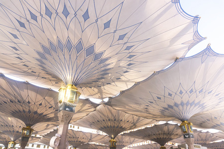 MEDINA - MARCH 06 : Underneath giant umbrellas at Nabawi Mosque compound on March 06, 2015 in Medina, Kingdom of Saudi Arabia. Nabawi mosque is the second holiest mosque in Islam. Editorial