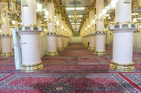 MEDINA-MAR 8 : Interior of Masjid Nabawi March 8, 2015 in Medina, Saudi Arabia. Nabawi Mosque is the second holiest mosque in Islam and here is Prophet Muhammad is laid to rest