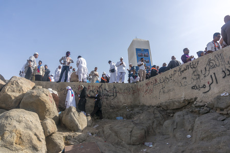 overthrown: MECCA, SAUDI ARABIA - MAR 11: Muslims at Mount Arafat (or Jabal Rahmah) March 11, 2015 in Arafat, Saudi Arabia. This is the place where Adam and Eve met after being overthrown from heaven. Editorial