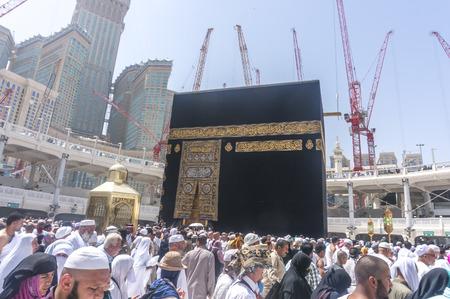 mohammad: MAKKAH - MAR 14 : Muslims look into Maqam Ibrahim (the station of Ibrahim) March 14, 2015 in Makkah, Saudi Arabia. Inside the Maqam Ibrahim is a stone block where Ibrahim stood to build the kaaba.