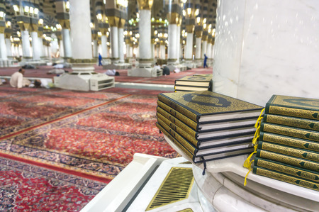 holiest: MEDINA-MAR 08 : A stack of Quran inside of Masjid Nabawi March 08, 2015 in Medina, Saudi Arabia. Nabawi Mosque is the second holiest mosque in Islam