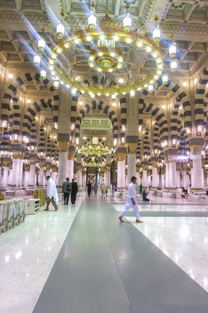 prophet: MEDINA, SAUDI ARABIA - MARCH 09, 2015 : Row inside Nabawi Mosque. Nabawi Mosque is the second holiest mosque in Islam and here is Prophet Muhammad is laid to rest Editorial