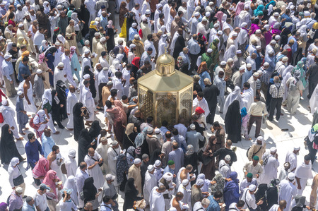 congregation: MAKKAH - MAR 10 : Muslims look into Maqam Ibrahim (the station of Ibrahim) March 10, 2015 in Makkah, Saudi Arabia. Inside the Maqam Ibrahim is a stone block where Ibrahim stood to build the kaaba.