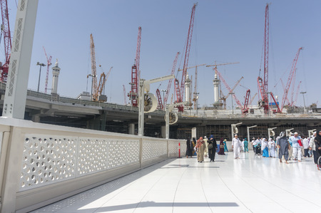 scheduled: MECCA, SAUDI ARABIA - MARCH 10 : Muslims tawaf from upper mataf at Haram Mosque March 10, 2015 in Makkah. The mosque expansion scheduled to complete in 2 years to accommodate more pilgrims during haj time. Editorial