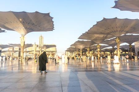 holiest: MEDINA, KINGDOM OF SAUDI ARABIA (KSA) - MAR 9 : Moslems walk outside Nabawi Mosque after dusk prayer March 09, 2015 in Medina, KSA. Nabawi Mosque is the second holiest mosque in Islam.