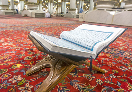 holiest: MEDINA-MAR 08 : A Quran inside of Masjid Nabawi March 08, 2015 in Medina, Saudi Arabia. Nabawi Mosque is the second holiest mosque in Islam Editorial