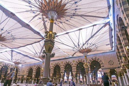 holiest: MEDINA-MAR 08:Muslims rest and pray inside of Masjid Nabawi March 08, 2015 in Medina, Saudi Arabia. Nabawi Mosque is the second holiest mosque in Islam and here is Prophet Muhammad is laid to rest